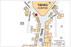Auf dem Lageplan ist der Standort vom Sporthaus am Tibarg mit einem roten Kreis gekennzeichnet.